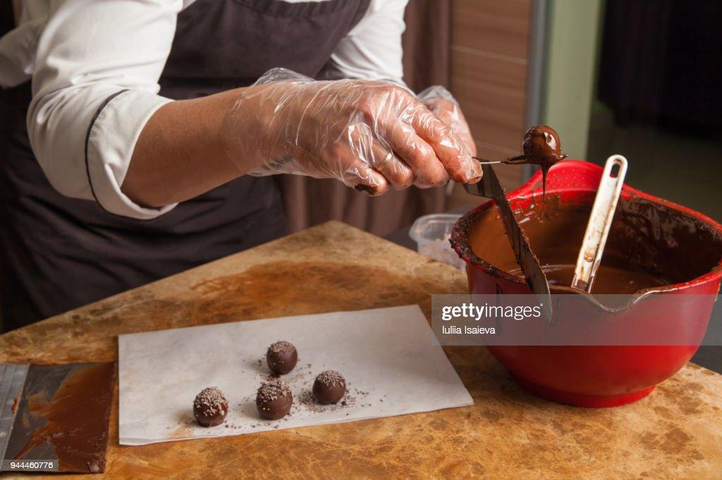 Crop pastry chef preparing candies : Stock Photo
