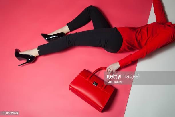 Crop stylish woman lying on floor
