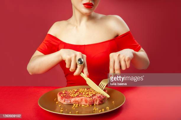 crop woman cutting raw meat - fork stock pictures, royalty-free photos & images
