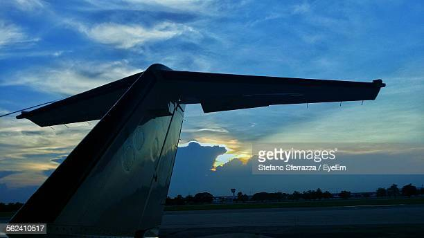 cropped airplane at airport runway at sunset - airplane tail stock pictures, royalty-free photos & images