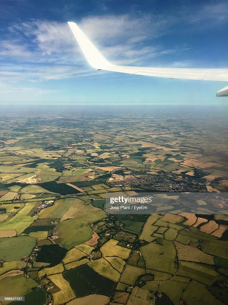 Cropped Airplane Flying Over Landscape : Stock Photo