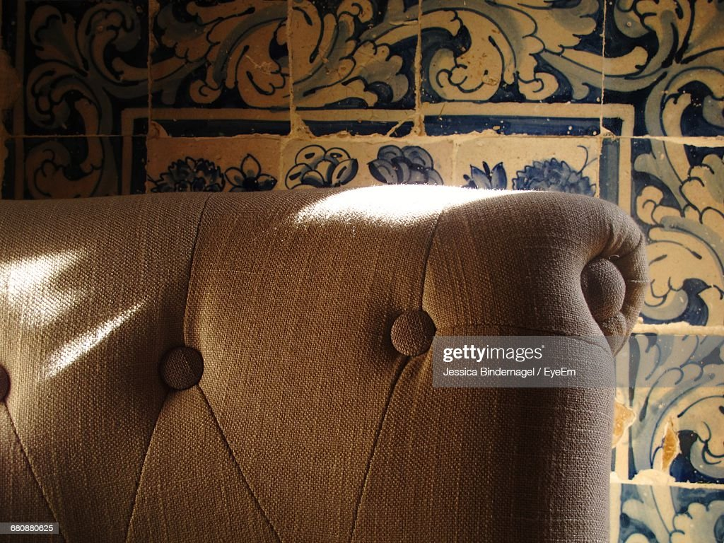 Cropped Chair Against Tiled Wall : Stock Photo