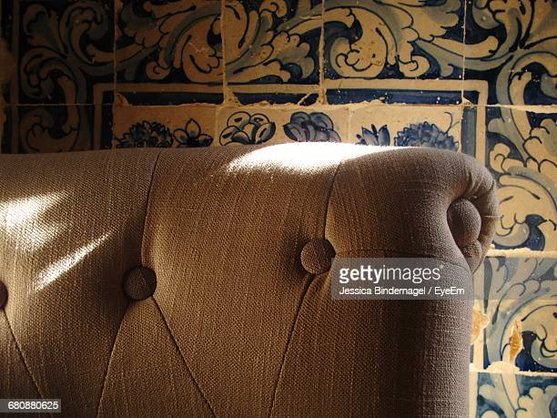 Cropped Chair Against Tiled Wall