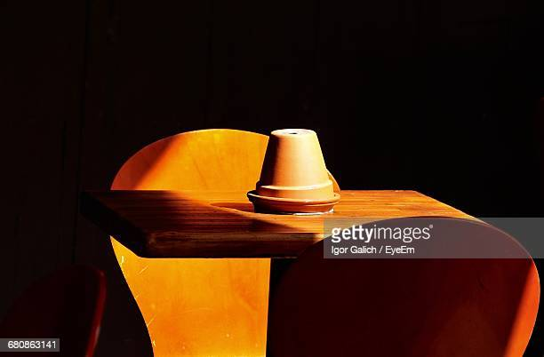 Cropped Chairs And Table Over Black Background