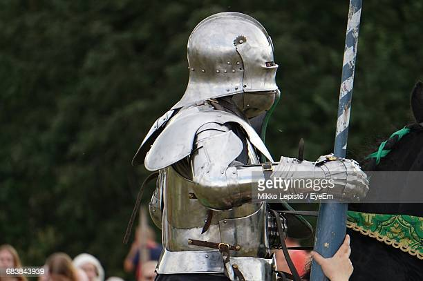 Cropped Child Holding Armor Suit