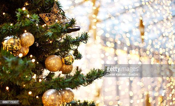cropped christmas tree with ornaments at night - christmas tree stock pictures, royalty-free photos & images
