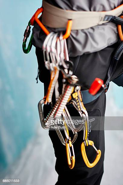 Cropped close up of carabiners on climbers harness