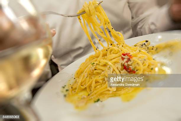 Cropped close up spaghetti on plate in restaurant