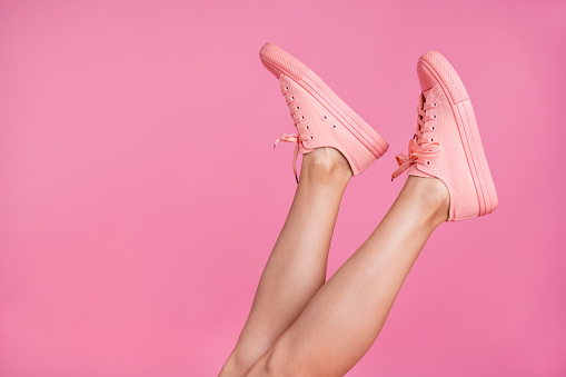 Cropped close-up image view photo of nice attractive feminine fit thin slim shaven legs active sport walk go steps trendy foot-wear isolated over pink pastel background 1129341836