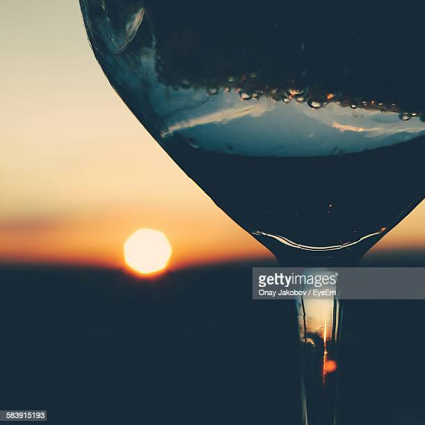 Cropped Cocktail Glass Against Sunset Sky