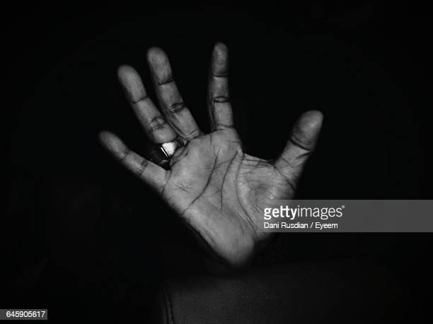Cropped Hand Against Black Background