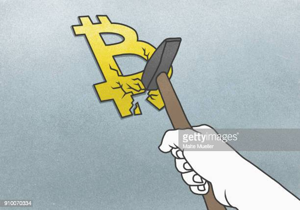 Cropped hand breaking Bitcoin symbol with hammer on gray background