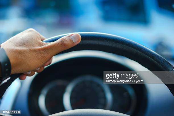 cropped hand driving car - steering wheel stock pictures, royalty-free photos & images