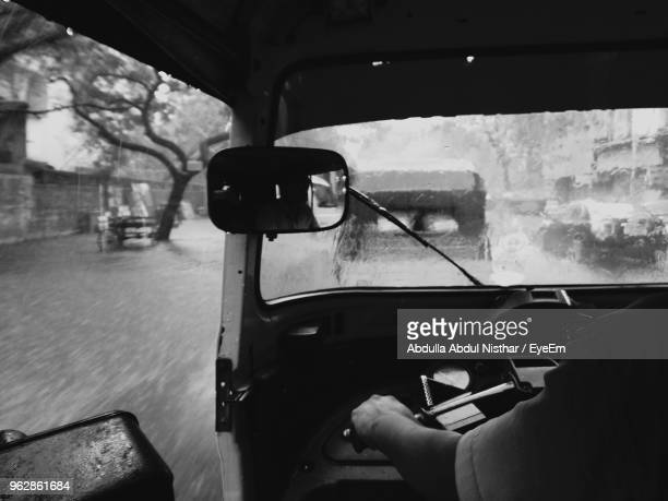 cropped hand driving jinrikisha during rainfall - monsoon stock pictures, royalty-free photos & images