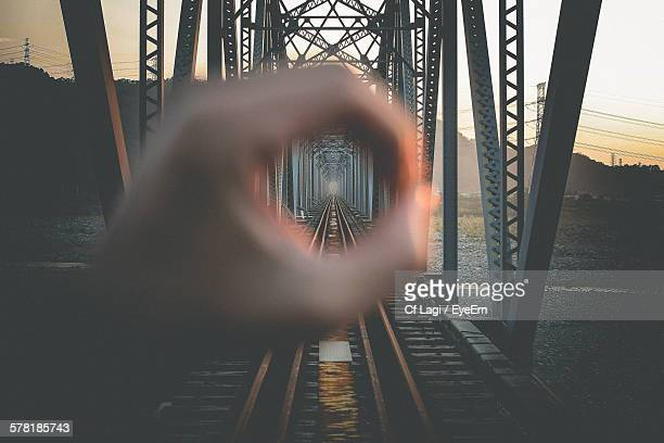 cropped hand forming circle in front of railway bridge - image focus technique stock pictures, royalty-free photos & images