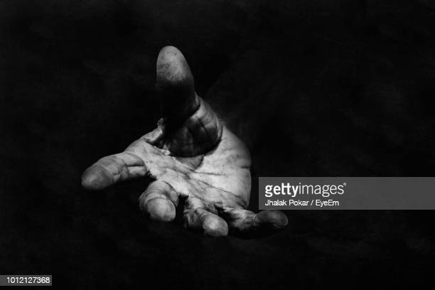 cropped hand gesturing against black background - black and white hands stock pictures, royalty-free photos & images