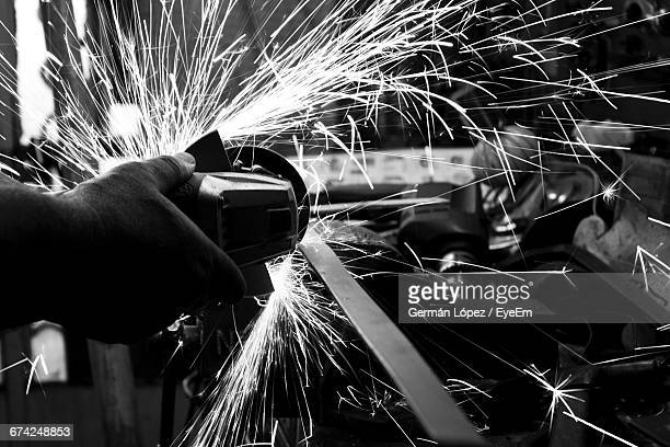 Cropped Hand Grinding Metal In Factory