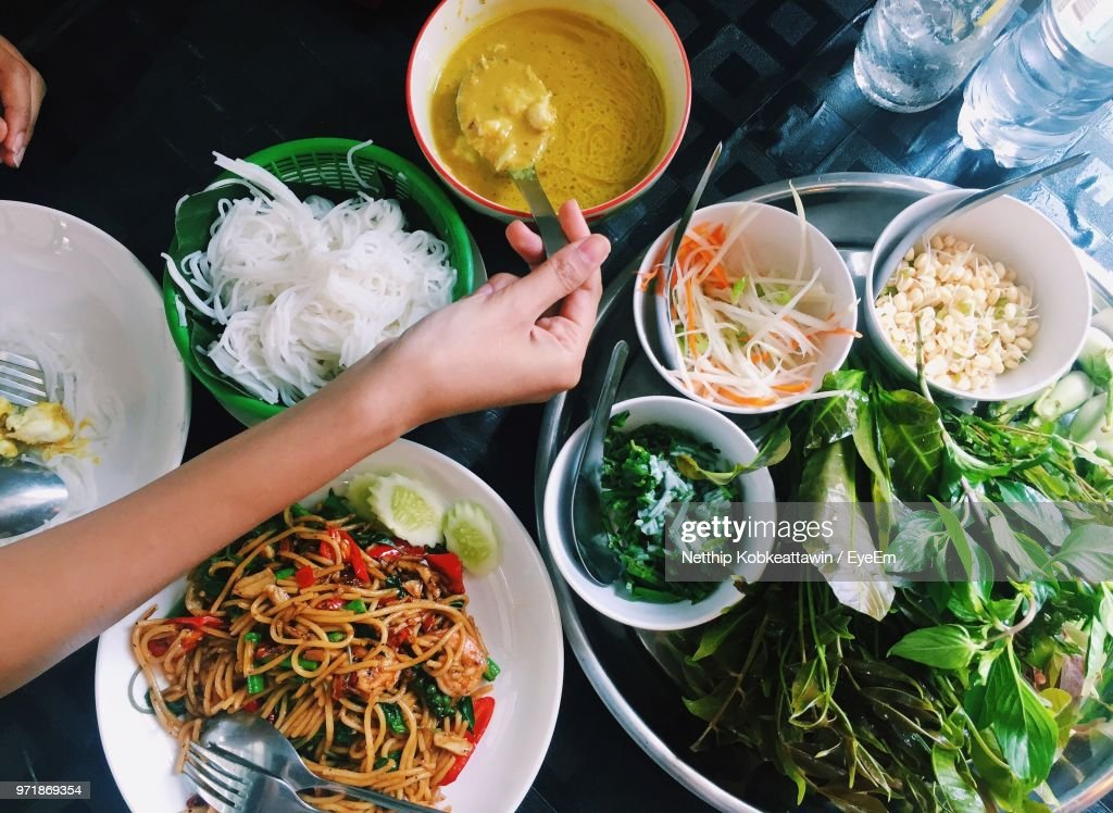 Cropped Hand Having Food At Table : Stock Photo