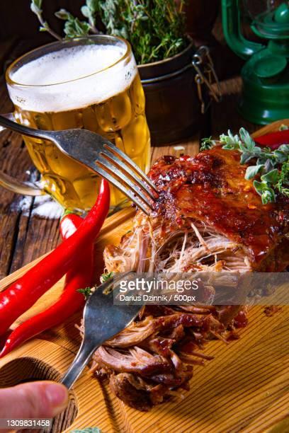 cropped hand having food on table - sloppy joe, jr stock-fotos und bilder
