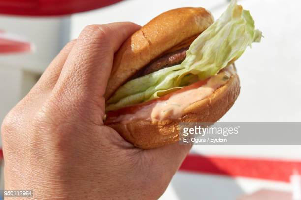 Cropped Hand Holding Burger