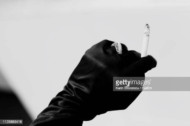 Cropped Hand Holding Cigarette
