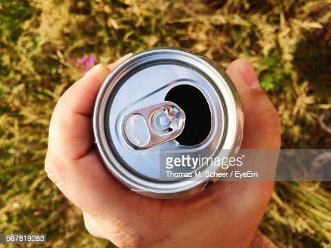 Cropped Hand Holding Drink Can