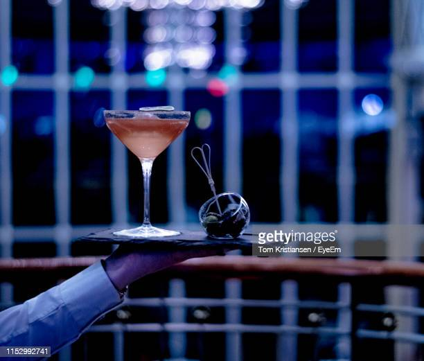 cropped hand holding drink - serving tray stock pictures, royalty-free photos & images