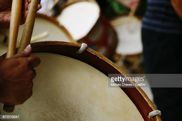 cropped hand holding drum - indian music stock photos and pictures