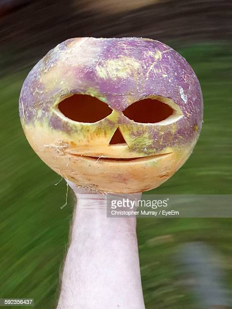 cropped hand holding face carved turnip - turnip stock pictures, royalty-free photos & images