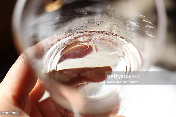 Cropped Hand Holding Glass Of Water At Home