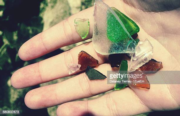 Cropped Hand Holding Glass Pebbles