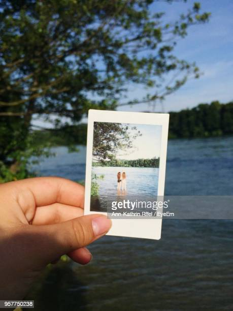 Cropped Hand Holding Instant Print Transfer By Lake