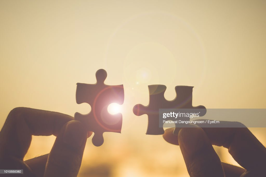 Cropped Hand Holding Jigsaw Pieces : Stock Photo