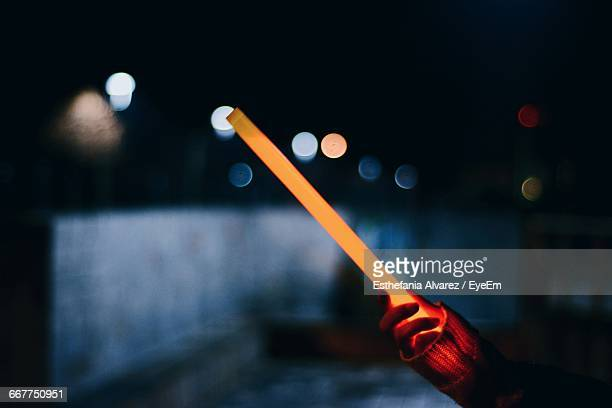 cropped hand holding laser sword at night - lightsaber stock pictures, royalty-free photos & images