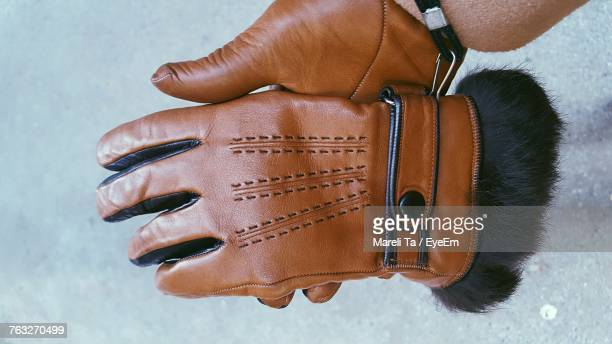 Cropped Hand Holding Leather Gloves During Winter