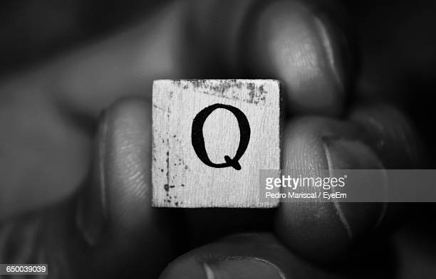 Cropped Hand Holding Letter Q Block