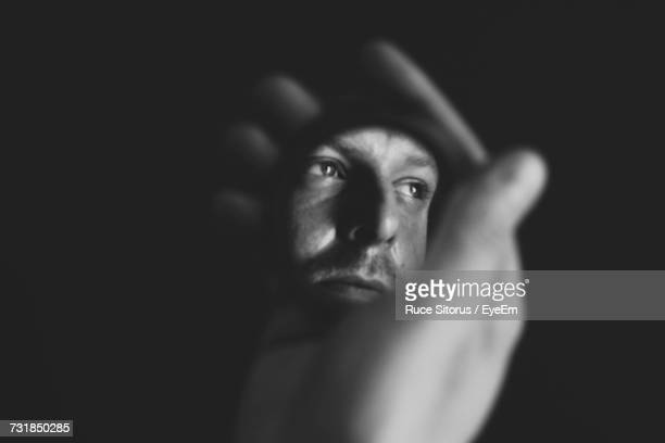 hand holding mirror. Cropped Hand Holding Mirror With Reflection Of Man Against Black Background