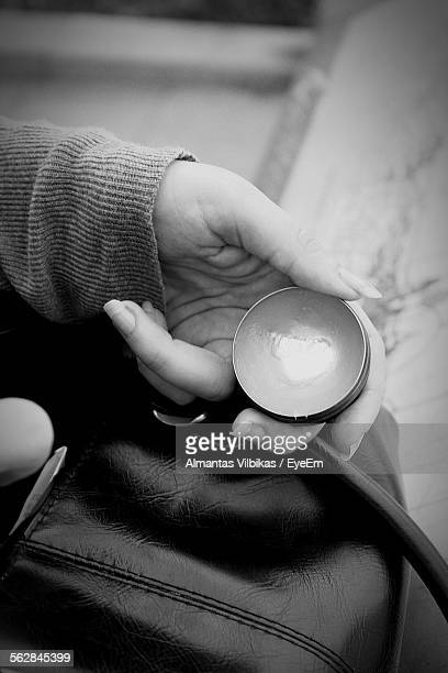 cropped hand holding petroleum jelly - vaseline stock pictures, royalty-free photos & images