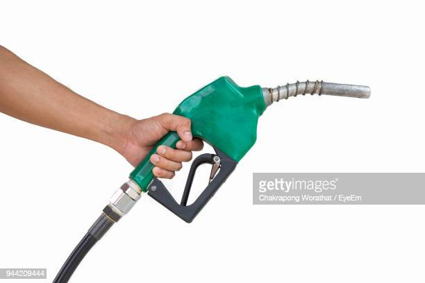 Cropped Hand Holding Refueling Oil Pump Against White Background