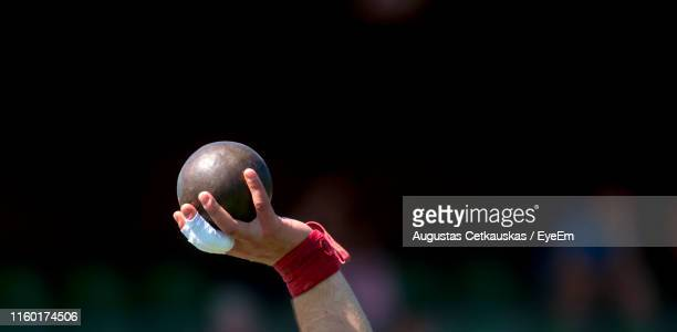 cropped hand of athlete holding shot put - shot put stock pictures, royalty-free photos & images
