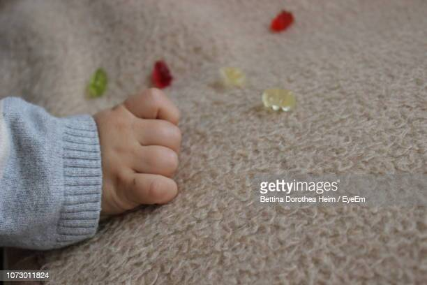 Cropped Hand Of Baby On Carpet
