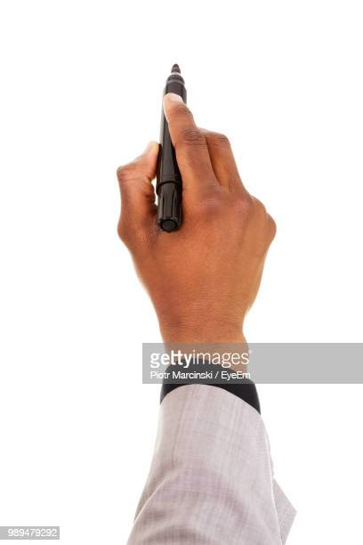 Cropped Hand Of Businessman Writing On White Background