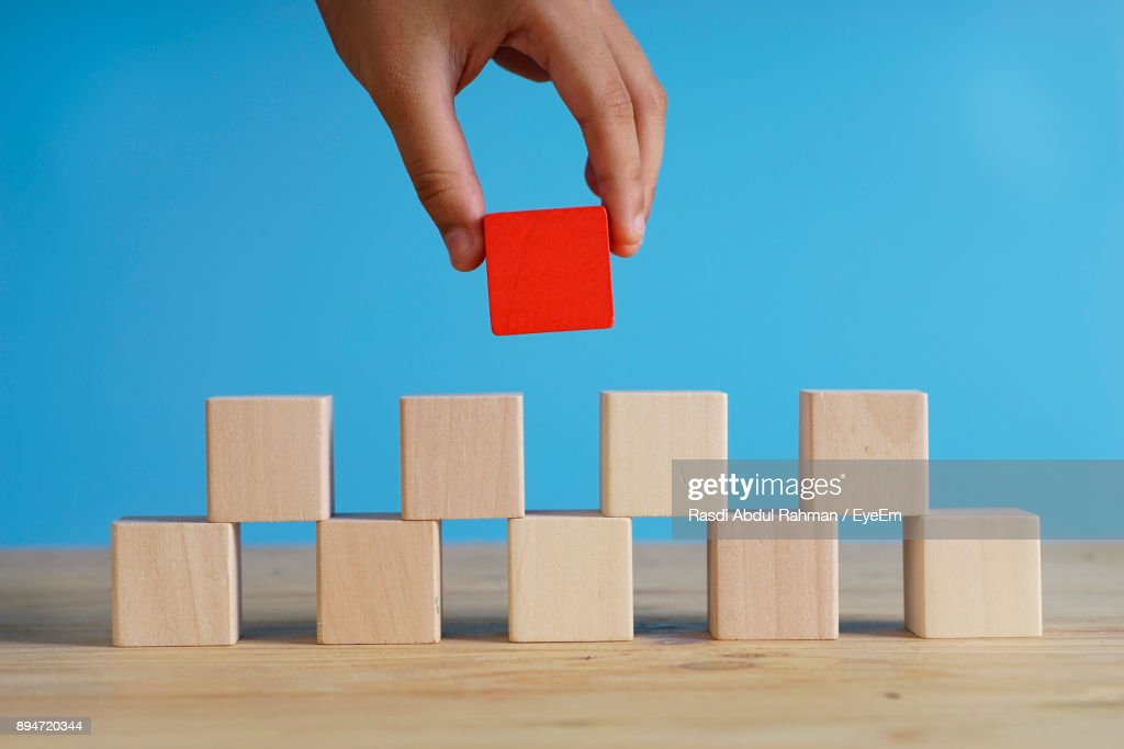 Cropped Hand Of Child Adjusting Blocks : Stock Photo