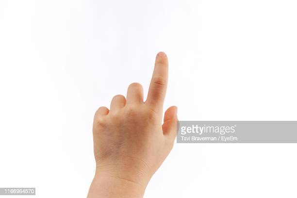 cropped hand of child gesturing against white background - index finger stock pictures, royalty-free photos & images