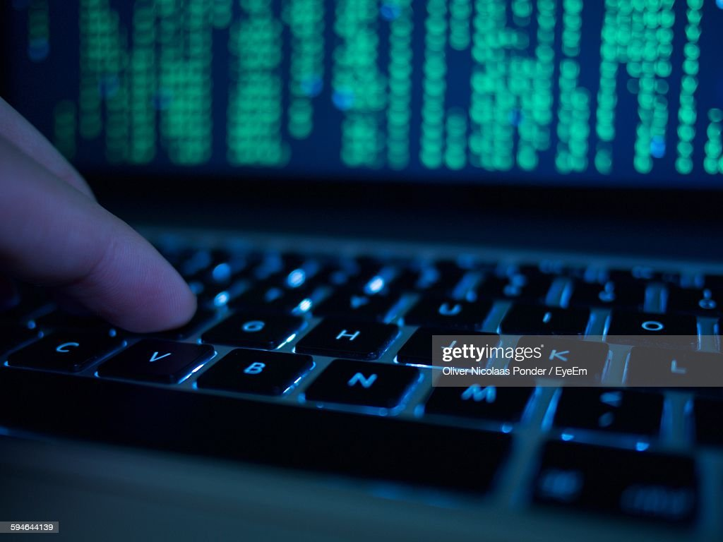 Cropped Hand Of Computer Hacker Typing On Keyboard : Stock Photo