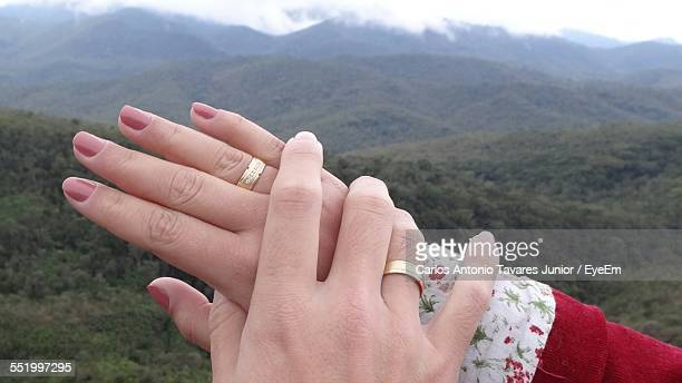 Cropped Hand Of Couple With Wedding Rings