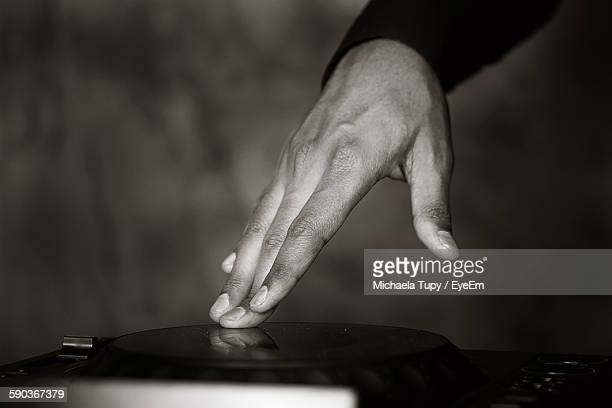 cropped hand of dj playing music - modern rock stock pictures, royalty-free photos & images