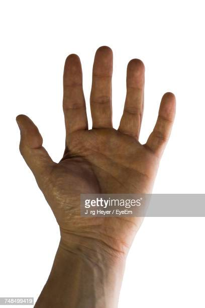 Cropped Hand Of Man Against White Background