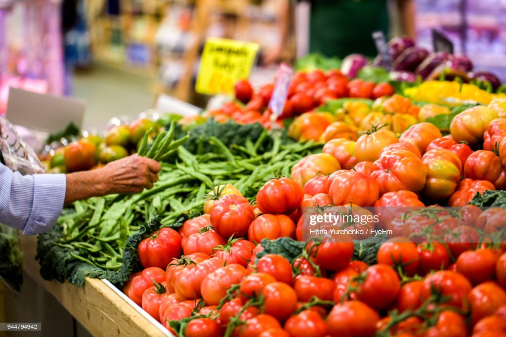 Cropped Hand Of Man Buying Vegetables At Market Stall : Stock Photo