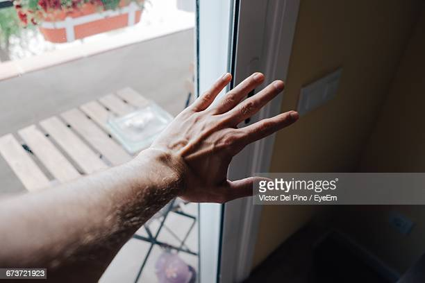 Cropped Hand Of Man By Door At Home